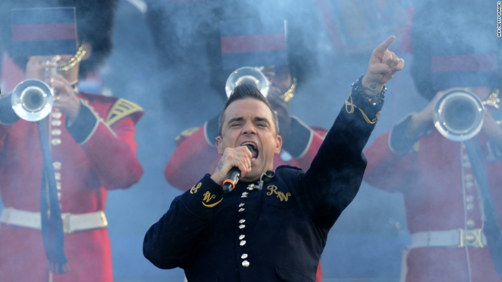 British singer-songwriter Robbie Williams performs on stage at the opening of the concert at Buckingham Palace.