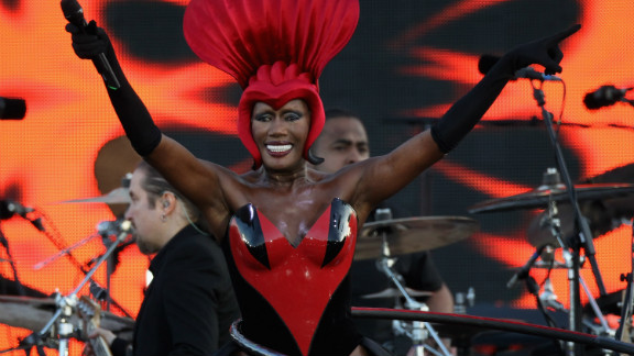 """Singer Grace Jones sings her hit """"Slave to the Rhythm"""" while spinning a hula hoop on her hips."""
