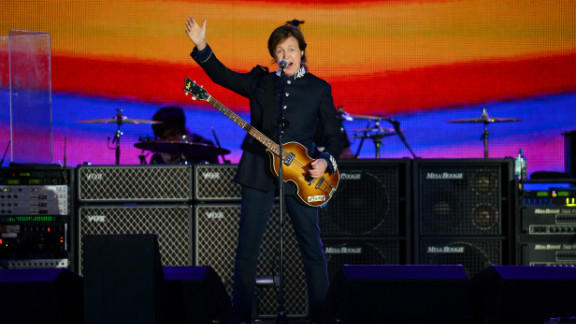 """Former Beatles singer Paul McCartney headlines at the queen's diamond jubilee concert. McCartney kicked off his set with """"Magical Mystery Tour."""""""