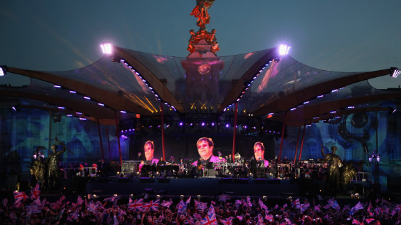 """Elton John began his set with """"I'm Still Standing,"""" perhaps also in homage to the queen's long reign."""