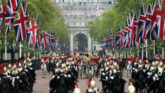 Horses ride down the Mall during the Diamond Jubilee Carriage Procession from Westminster Hall to Buckingham Palace.