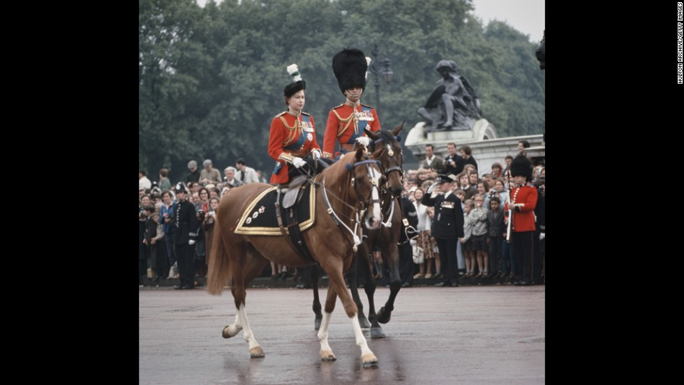 The royal couple return to Buckingham Palace after a ceremony in June 1965.