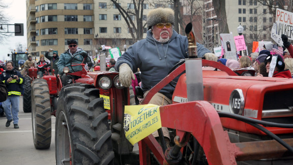 Farmers drive past the Wisconsin State Capitol during a rally March 12, 2011, in Madison.