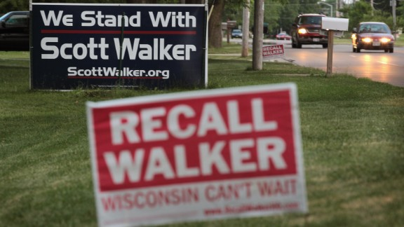 Opposing signs along a rode in Beloit, Wisconsin, can be seen on June 4, the day before voting in the recall election.