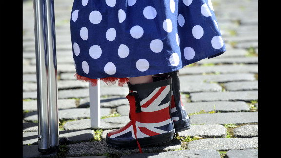 A small girl wears Union Jack boots and a skirt in Britain