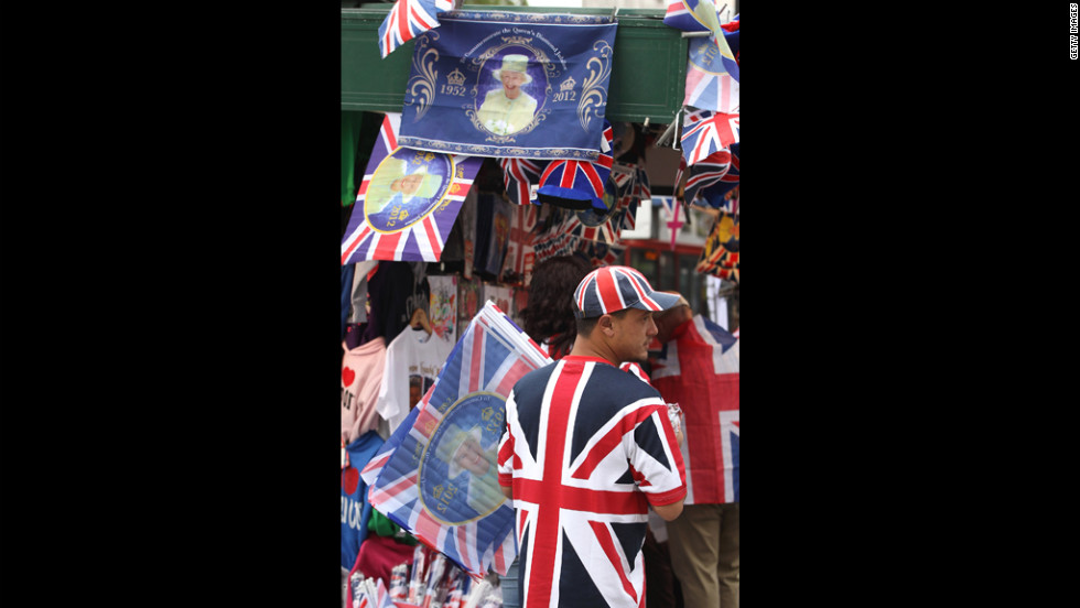 A vendor sells Union Jack and Diamond Jubilee memoribilia.