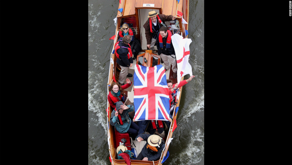 Revellers enjoy the River Pageant on the River Thames.