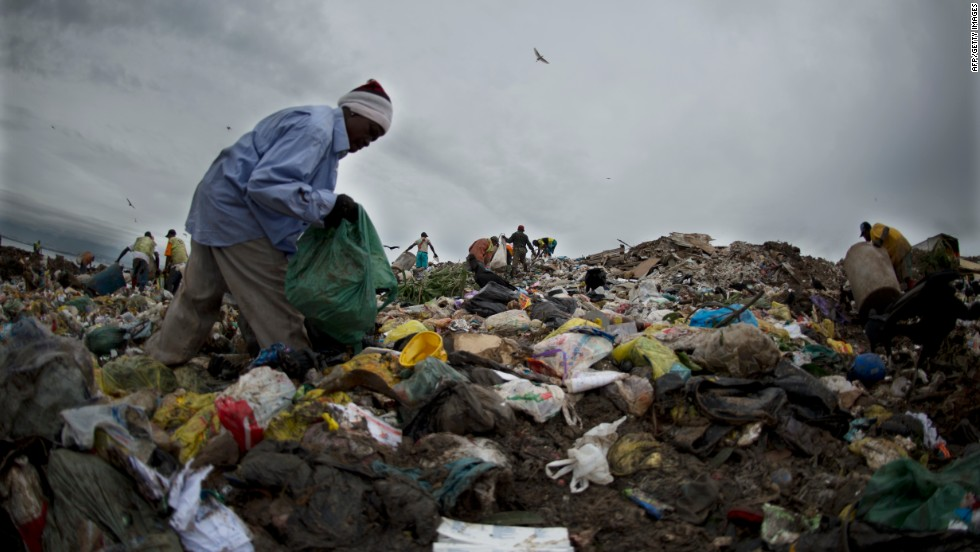 "A <em>catadore</em> sifts through the trash at the Jardin Gramacho landfill site in Rio de Janeiro. The facility was closed in 2012 but featured as the backdrop for the 2010 Oscar nominated movie, ""Wasteland."""