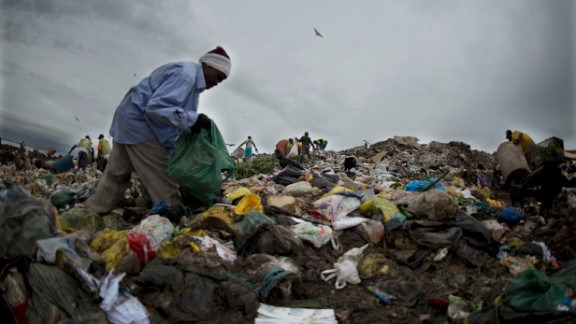 A catador, or scavenger, picks through trash at Jardim Gramacho, a massive landfill in Rio de Janeiro, Brazil. The three-decades old landfill was shut down Sunday.