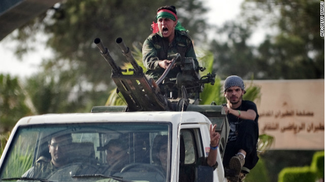 Libyan government forces arrive at Tripoli international airport on June 4, 2012.
