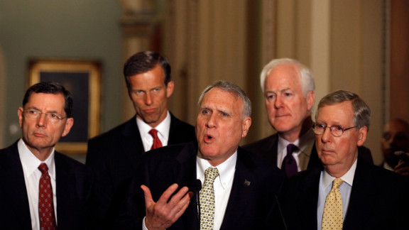 Sen. Jon Kyl of Arizona answers reporters' questions alongside other Republican senators after the equal-pay vote.