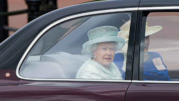 Queen Elizabeth II and Diana Marion, The Lady Farnham, drive down the Mall on their way to St Paul