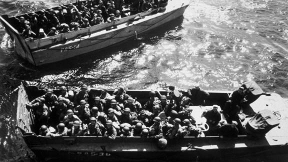 U.S. troops wait to disembark a landing craft on D-Day.