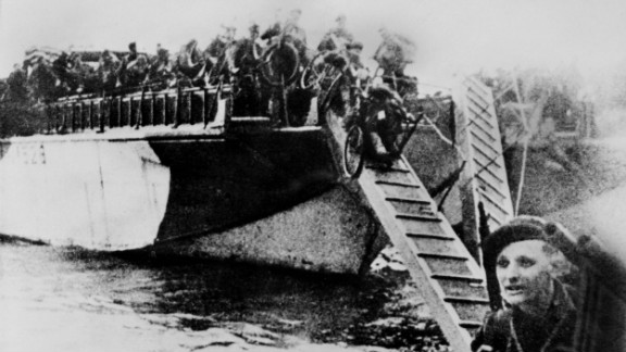 French commandos equipped with bicycles disembark from their landing craft after Allied forces stormed the Normandy beaches. Germans rained mortars and artillery down on Allied troops, killing many before they could even get out of their boats. Fighting was especially fierce at Omaha Beach, where Nazi fighters nearly wiped out the first wave of invading forces and left the survivors struggling for cover.