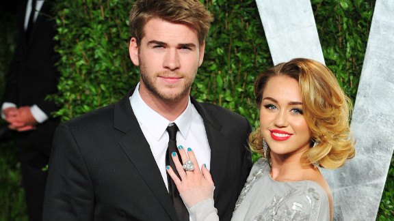 """After months of a rumored commitment, Miley Cyrus, 19, is officially engaged to Liam Hemsworth, who she met when the pair co-starred in """"The Last Song"""" in 2009. The 22-year-old Australian actor proposed to Cyrus on May 31 with a 3.5-carat diamond, according to People magazine. Cyrus isn't the only celebrity to get engaged young. We are taking a look at which other stars have accepted a marriage proposal during their teenage years."""