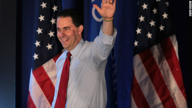 Wisconsin GOP Gov. Scott Walker waved to supporters Tuesday night after surviving a recall effort launched against him.