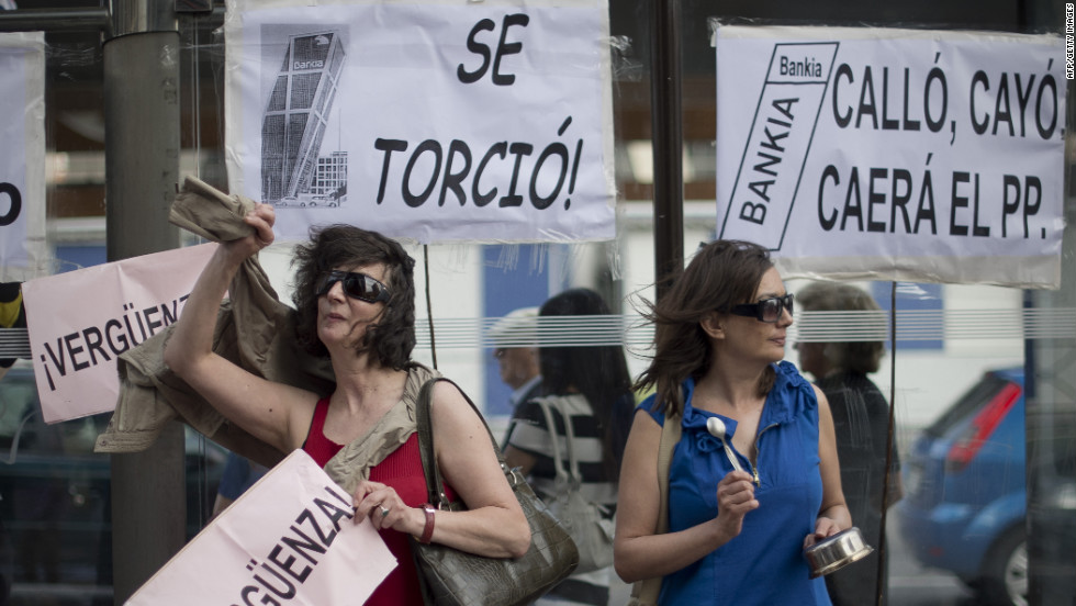 People demonstrate against Spain's banking sector in front of Bankia, on June 02, 2012. Bankia asked for €19 billion in aid.