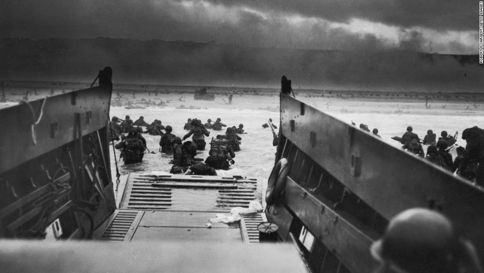 American troops storm the beaches of Normandy, France, on June 6, 1944. D-Day was the largest amphibious invasion in history. More than 160,000 Allied troops -- about half of them Americans -- invaded Western Europe, overwhelming German forces in an operation that proved to be a turning point in World War II.
