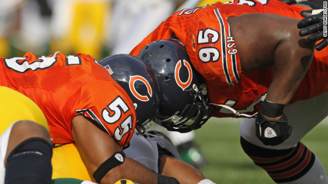 Two Chicago Bears players collide on a tackle against the Green Bay Packers in 2011.