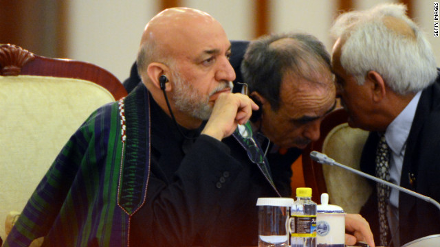 Afghan President Hamid Karzai will cut short his China trip to return to Afghanistan after a NATO strike reportedly killed civilians.