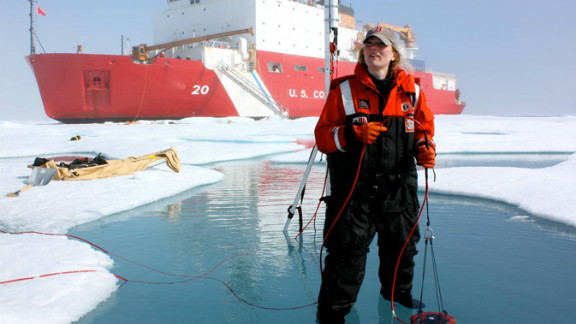 ICESCAPE scientist Karen Frey takes optical measurements in a melt pond, which lets four times as much light through to the sea below as snow-covered ice.