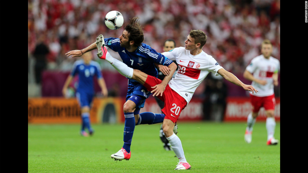 Lukasz Piszczek of Poland and Georgios Samaras of Greece battle for the ball during the opening match.