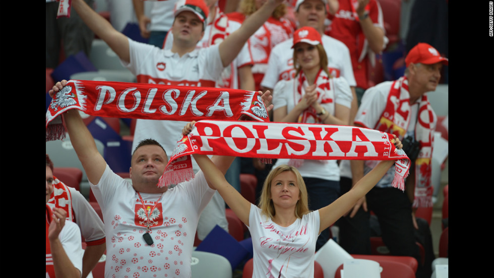 Polish fans hold up banners before the Euro 2012 match between Poland and Greece.