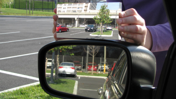 The newly patented mirror, above, shows a much wider view compared to a standard side-view mirror.