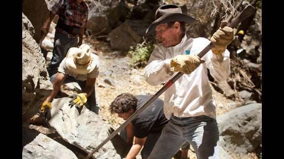 Volunteer Jeff Richter uses a pry bar to move a large rock at Gardner Springs in the Miller Peak Wilderness area.