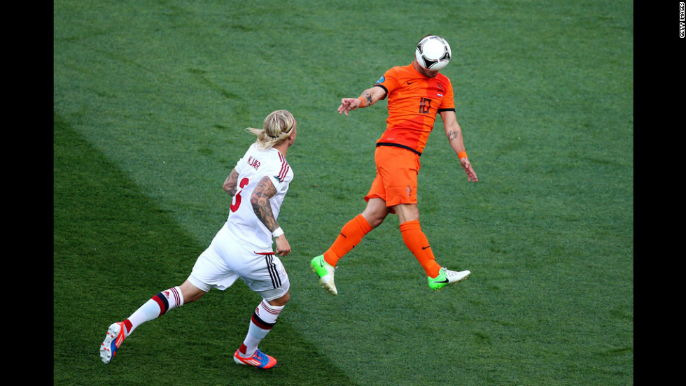 Wesley Sneijder of the Netherlands heads the ball during the match against Denmark.