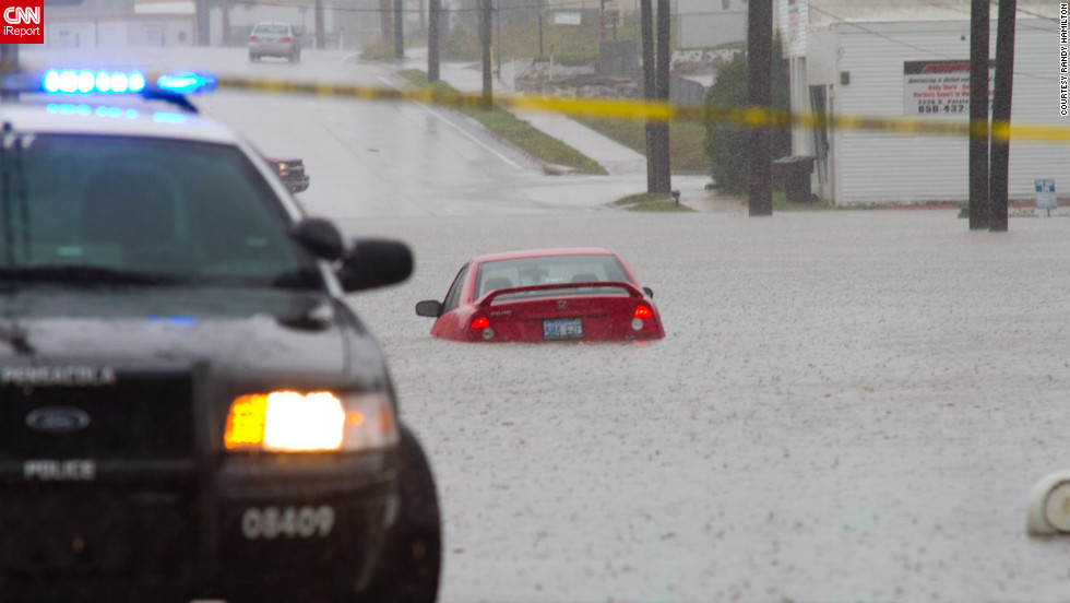 "Cars struggled with flooded roads Saturday in Pensacola. ""These are areas I have never seen flood like this, and we have endured some pretty big hurricanes through here before,"" iReporter Randy Hamilton says."