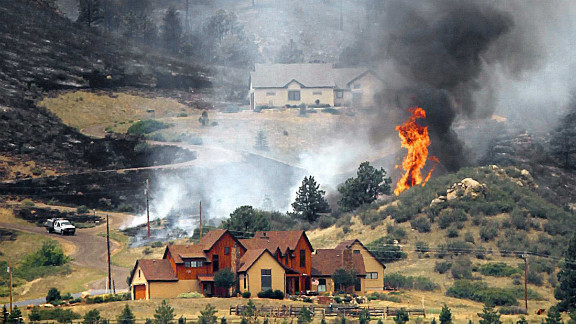 Flames threaten houses on the eastern front of the High Park fire near Laporte on Sunday, June 10.