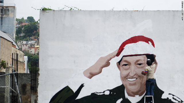 A mural of Venezuelan President Hugo Chavez goes up last week in Caracas. Chavez has led Venezuela since 1999.