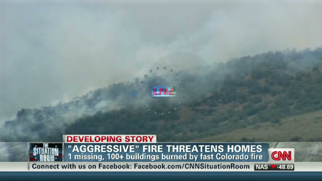 'Out of control' fire threatens homes