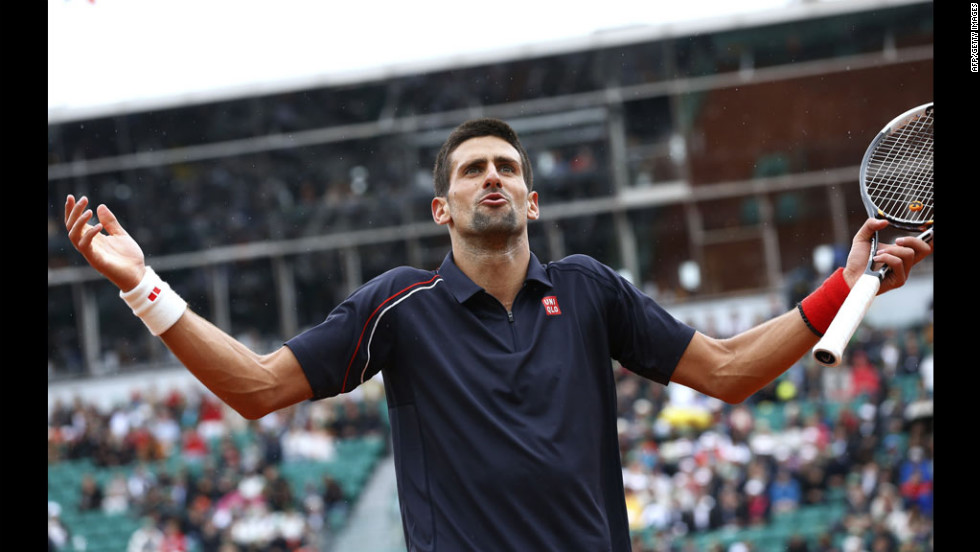 Djokovic reacts in frustration late in the match against Nadal.
