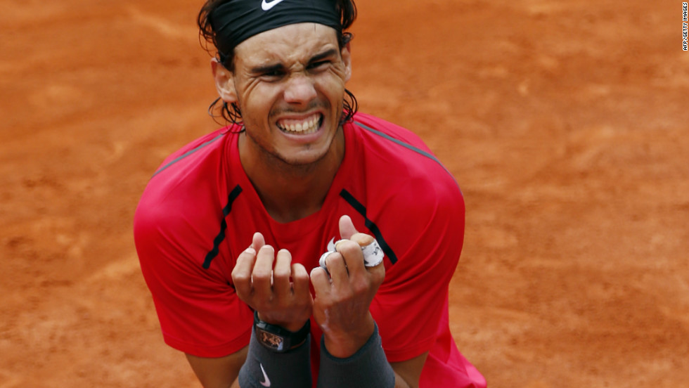 The Spaniard became the first male player to win the clay-court tournament seven times, moving clear of Bjorn Borg after completing a rain-delayed victory over world No. 1 Novak Djokovic.