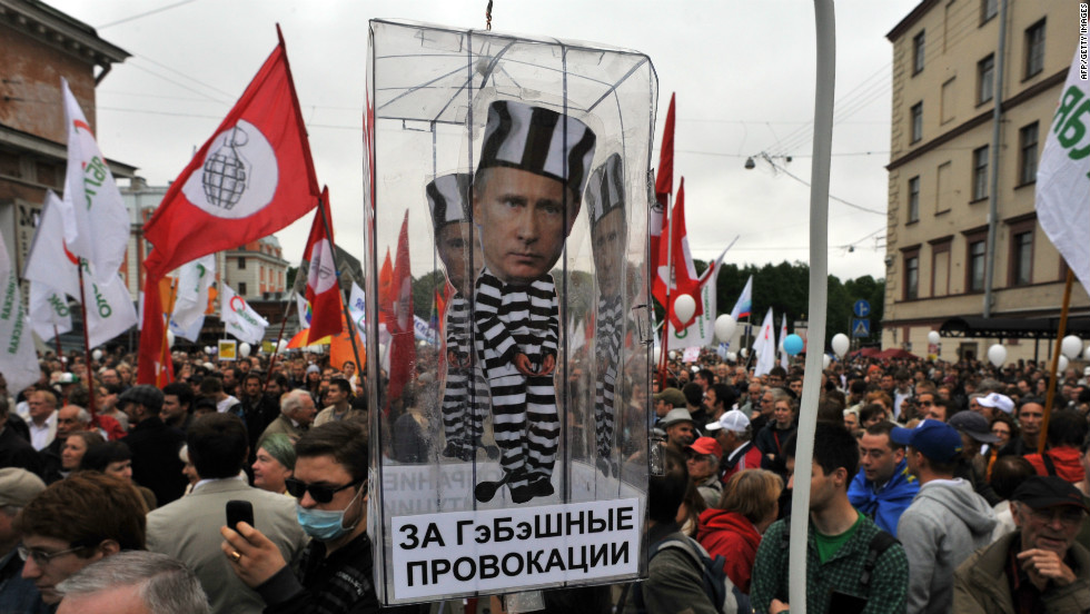 Opposition activists carry a carry a model of a prison cell with the cut-out figure of Putin during a rally in St. Petersburg.
