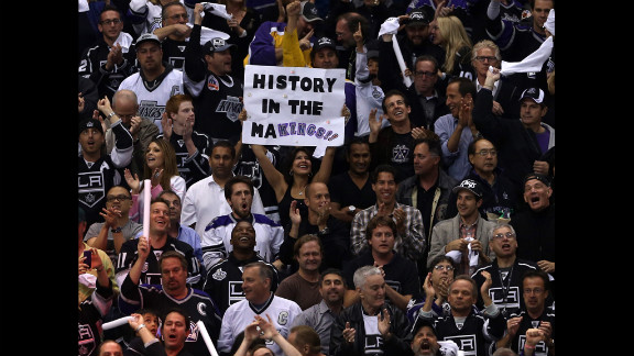 """A Kings fan holds up a sign that reads, """"History in the Makings."""" Leading up to game six, the team's 3-0 series lead was cut to 3-2."""