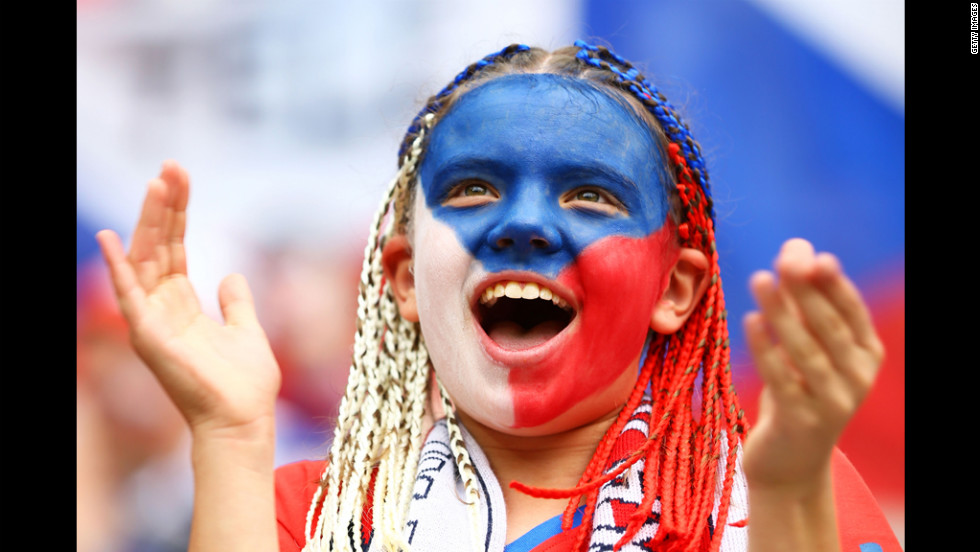 A fan cheers during the Greece-Czech Republic match Tuesday at the Municipal Stadium in Wroclaw.