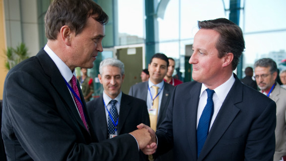 File photo of Britain's ambassador Dominic Asquith, left, with Prime Minister David Cameron in Tripoli on September 15, 2011.