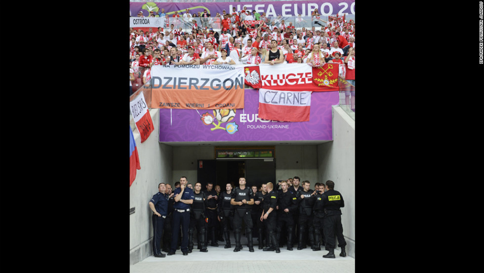Polish police stand at one of the entrances to the pitch before the Group A preliminary round match.