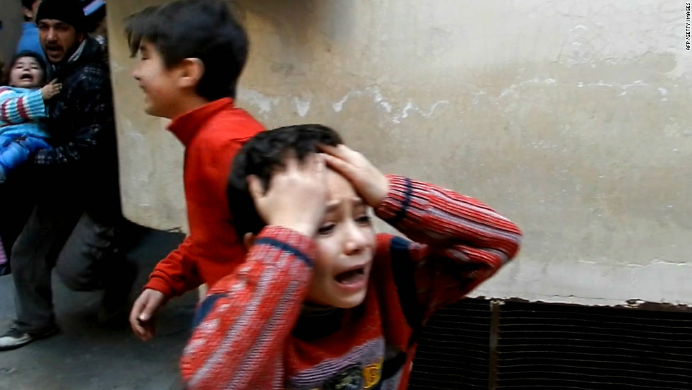 Photography is one of the most important journalistic tools to tell a story.  The following photos illustrate some of the tragedies that have profoundly changed the world. Here, children are shown in distress during fighting in the restive city of Homs in Syria, in February.