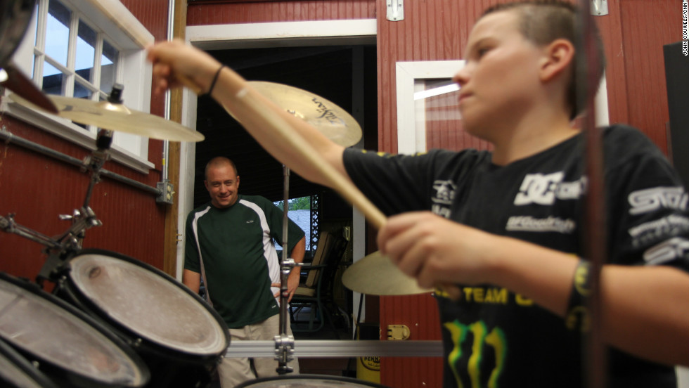 Watson hasn't had to sell the drum set, which both father and son play. The love of drums unites the two, who relentlessly tap their fingers on the kitchen table when they're not playing.