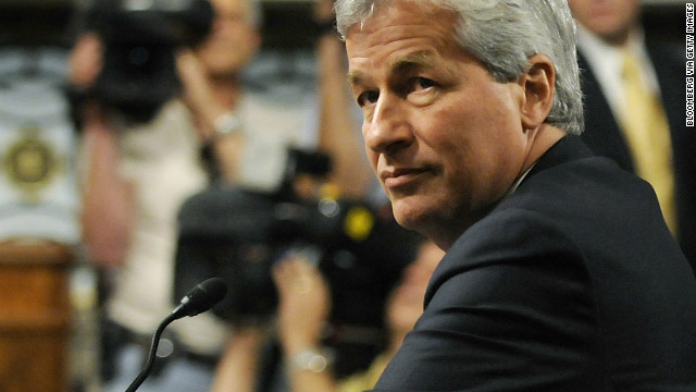 Jamie Dimon, chief executive officer of JPMorgan Chase & Co., takes his seat as he arrives to a Senate Banking Committee hearing in Washington, D.C., U.S., on Wednesday, June 13, 2012. Dimon will tell Congress the bank let traders take risks they didn't understand but not answer key questions about more than $2 billion in trading losses, according to prepared testimony. Photographer: Jonathan Ernst/Bloomberg via Getty Images