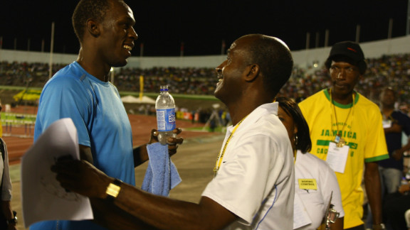 Bolt greets his inspiration, 1976 Olympic 200m champion Don Quarrie.