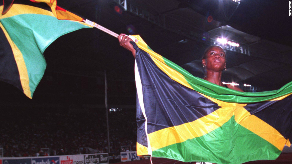 Merlene Ottey shows off the Jamaican flag after her gold medal success at the 1993 World Championships in Stuttgart.
