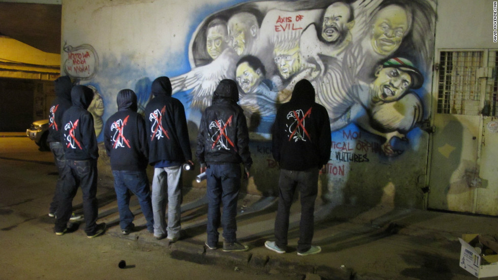 The graffiti gang steps back and admires their latest work. Each wears the 'anti-vulture' jacket.