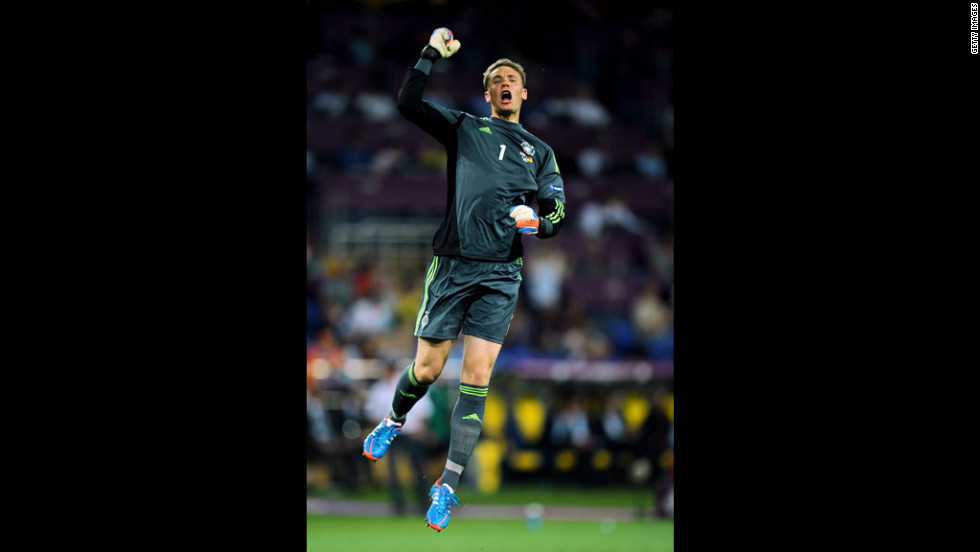 Manuel Neuer of Germany celebrates after Mario Gomez scored the opening goal against the Netherlands.