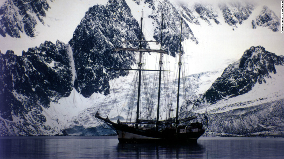 "Many of these ships have been beautifully restored and are still in use today. This is the Dutch three-masted schooner ""Osterschelde"" that was built in 1918 and restored in the 1990s. She still does annual around-the-world trips. Here she is sailing in Norway's Arctic archipelago Svalbard."