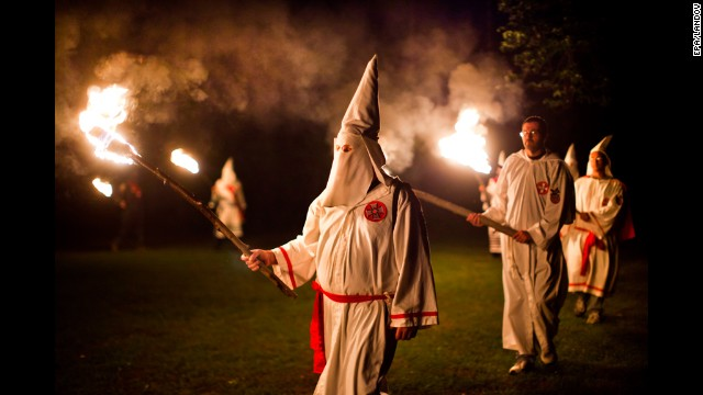 Image #: 15491026    epa02942302 (20/25) Members of the Knights of the Southern Cross of the Ku Klux Klan (KSCKKK), joined by members of other Virginia Klan orders, hold a cross lighting ceremony on private property near Powhatan, Virginia, USA, 28 May 2011. The Invisible Empire is experiencing a revival in the Commonwealth of Virginia. Three chapters of the Ku Klux Klan have reemerged in the state, holding rallies, lighting crosses, and seeking new members. Anger over gay rights, racial changes in the population, and a black president are frequent refrains at these rallies. Yet Klan members say they are not about hate, but about taking pride in their own race. 'The blacks have the NAACP [The National Association for the Advancement of Colored People], the Mexicans La Raza, and the Jews have the ADL [the Anti-Defamation League],' says Stan Martin of the Rebel Brigade Knights of the Ku Klux Klan. 'We whites have the Ku Klux Klan.'  EPA/JIM LO SCALZO /LANDOV
